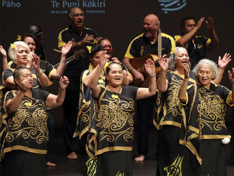 A group of Māori elders perform singing and dancing