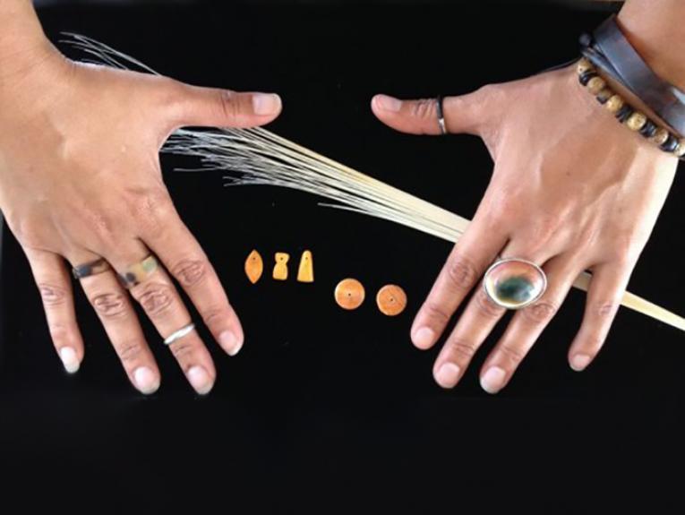 The hands of Kerri-Ann Borja, a carver from Guam