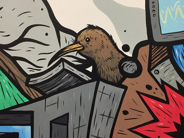 Close-up of a wall illustration, focusing on the kiwi
