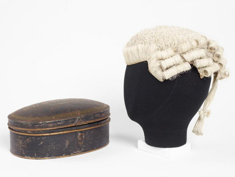Barrister's wig and wig tin, circa 1905, England, by Ede & Ravenscroft. Gift of Dr Judy Malone, 2013. CC BY-NC-ND licence. Te Papa (GH017822)