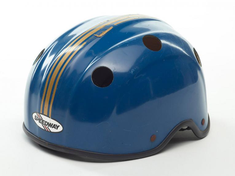 A blue helmet with gold stripes