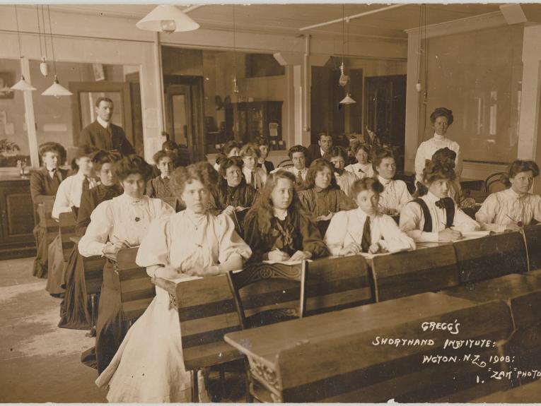 an old photo of school children in a school room