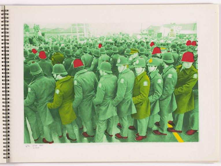 Screenprint of a photo of a large group of police. It has been coloured green, with the occasional red helmet and shoes