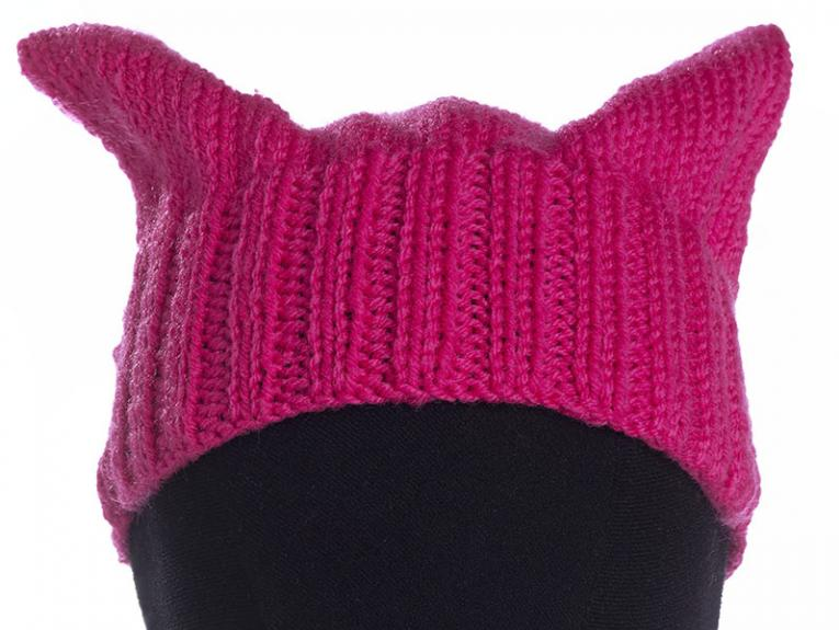 Knitted hat in pink and with cat ears