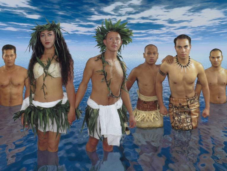 Crop from a poster featuring six people in traditonal Pacific clothing standing in a vast expanse of water with a vast skuy above them.