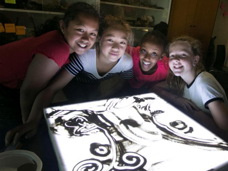 Photo of children creating sand art