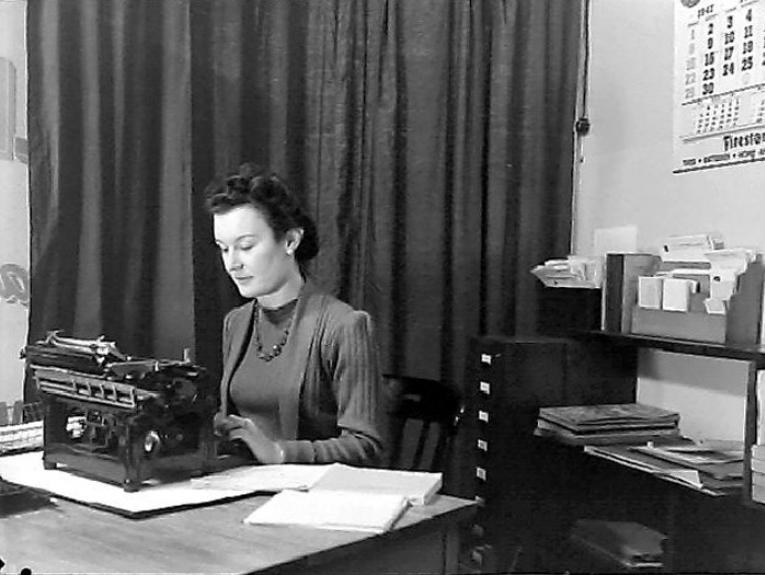 Woman at Desk, 1947, by Gordon Burt, Gordon H. Burt Ltd. Te Papa (B.026730)