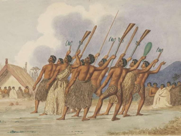 A group of Māori perform a haka with various weapons, including guns, raised in the air
