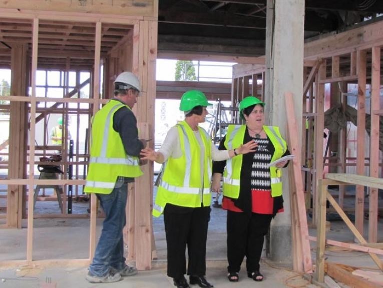 Museum Development Adviser Sally August tours the new Western Bay Museum, 2015. Photograph by and courtesy of Chris Steel/Katikati Advertiser