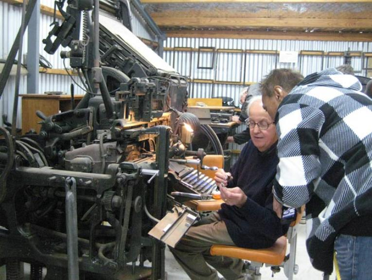 Typesetting demonstration at Okains Bay Museum, 2013. Photograph by Judith Taylor, Te Papa