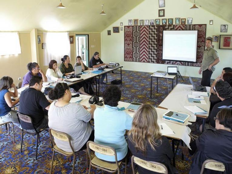 Photographer Michael Hall leads a digital photography for iwi workshop at Moteo Marae