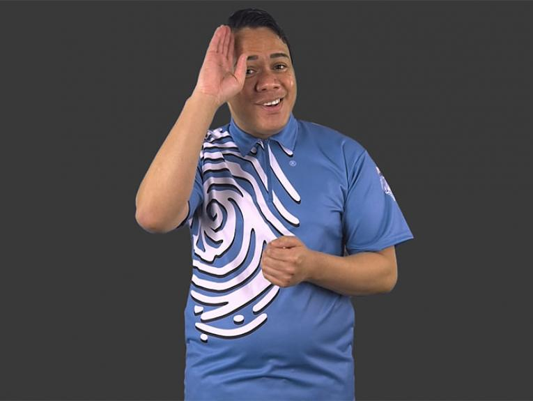 "Screenshot of video. A man in Te Papa Host uniform signs ""hello"""