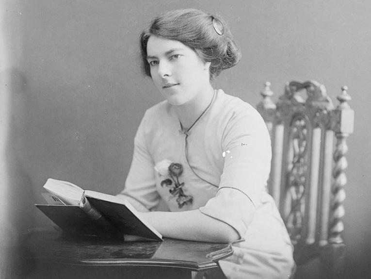 Black and white photograph of a woman reading
