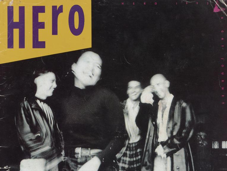 Black and white blurry photo of four people and the word Hero on the top-left corner