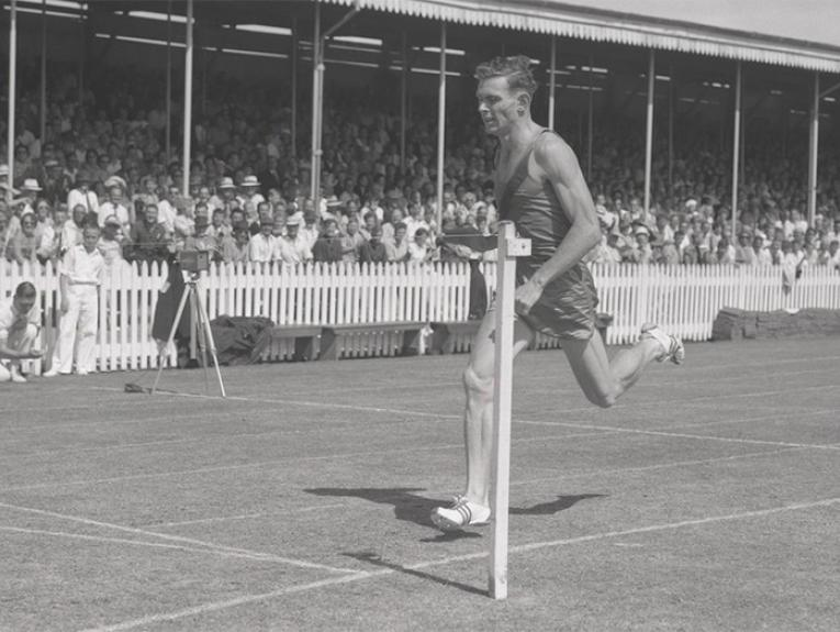 Peter Snell breaking the world record for the 800m at the AGFA Athletic meeting, Lancaster Park, Christchurch, February 1962 and is from Archives New Zealand's National Publicity Studios Collection.