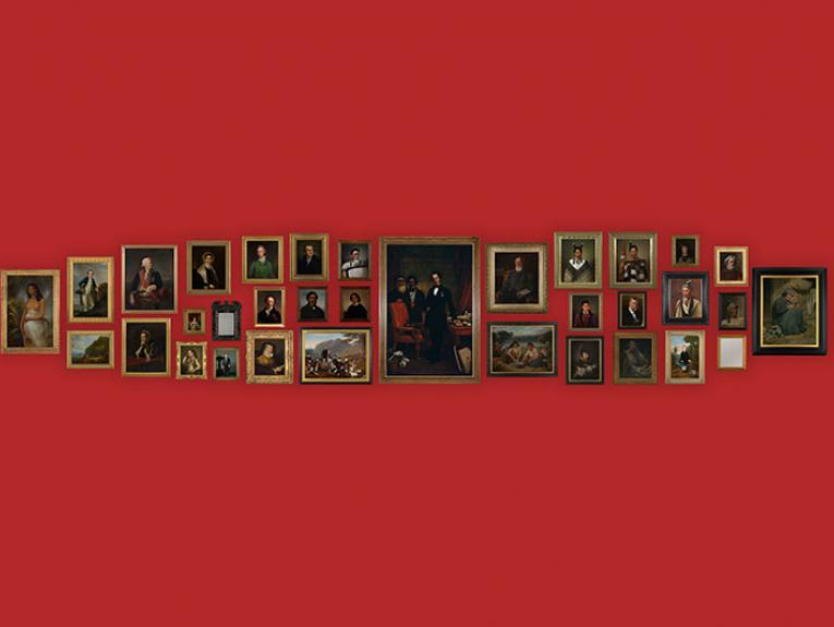 A selection of portraits lined up on a red wall