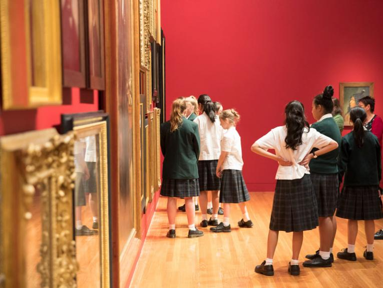 Students look at historical art
