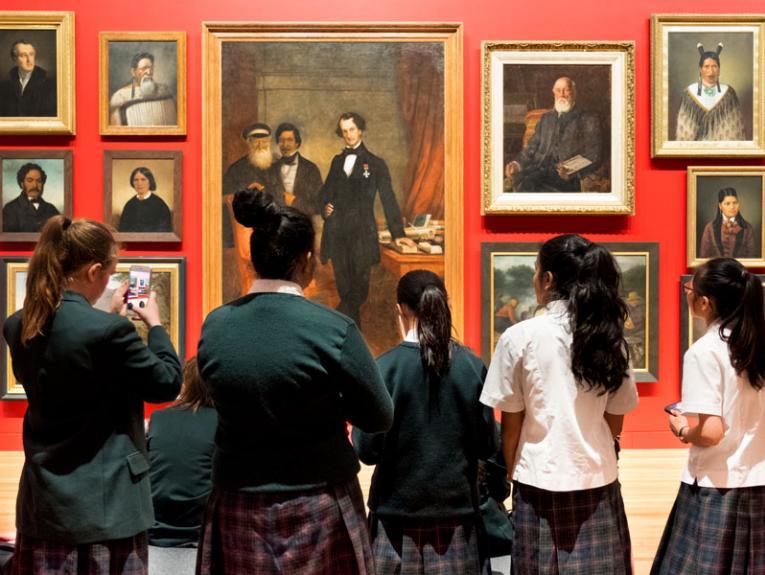 Students look at portraits