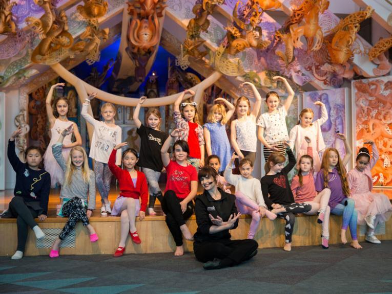 children pose at a ballet workshop