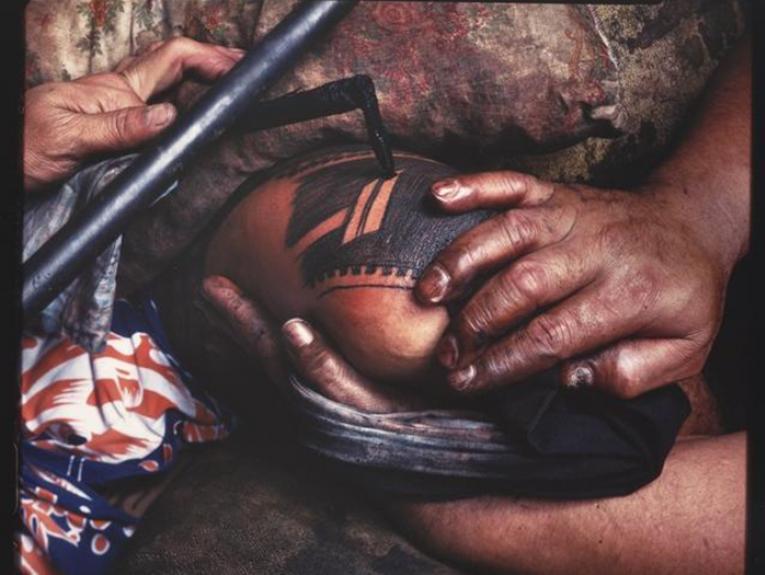Samoan tatau being undertaken 1982