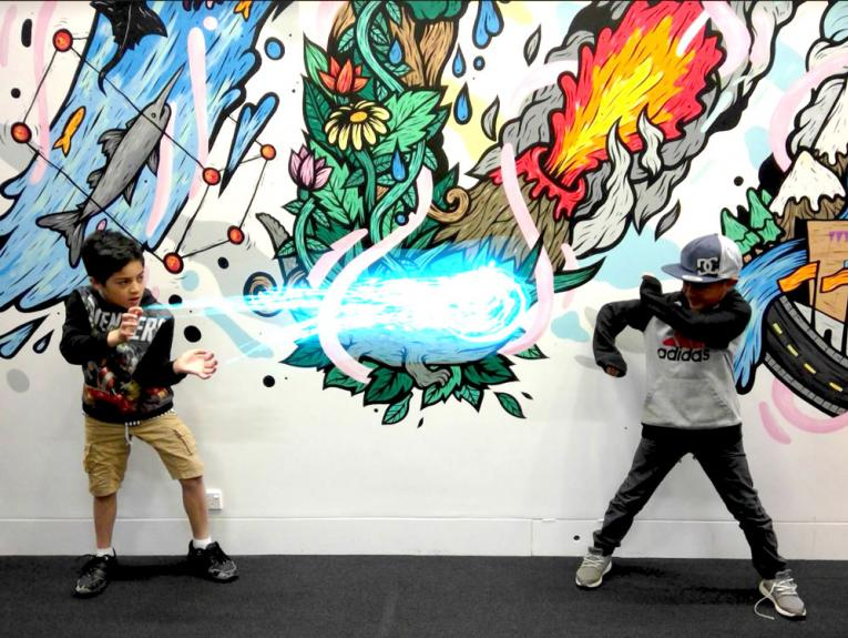 Two boy through a digital 'ice' ball at each other