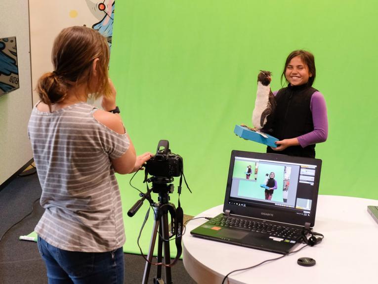 Kids using Green Screen technology
