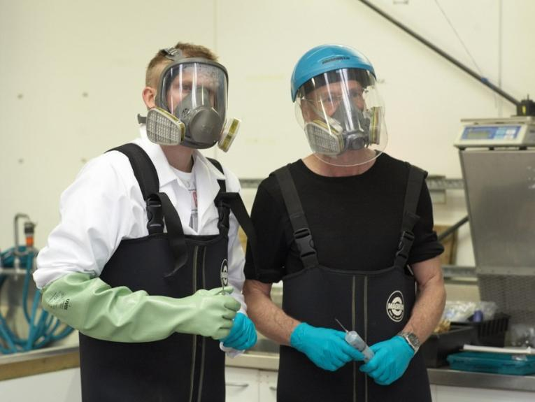 Scientist wear a full-face mask