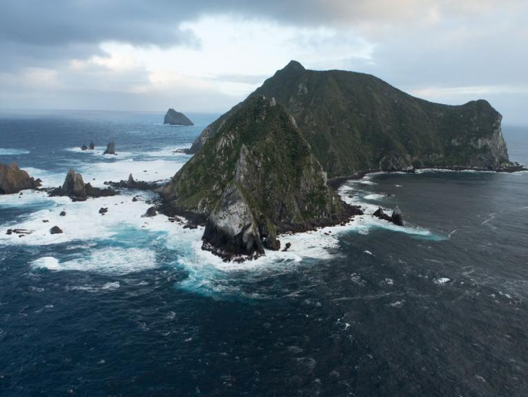 Cliffs and rough sea of Solander Island