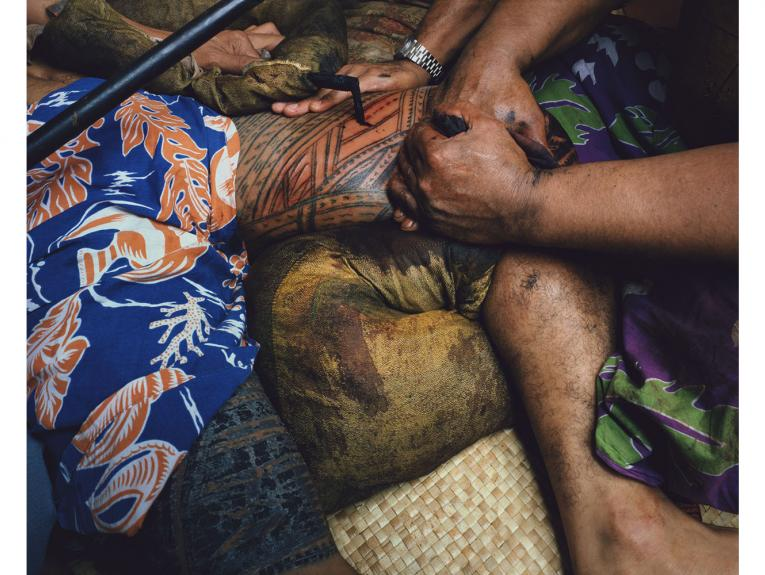 Close-up of a person getting a Samoan tattoo