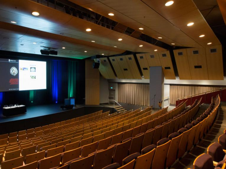 Inside Soundings Theatre showing the screen, stage, and seating