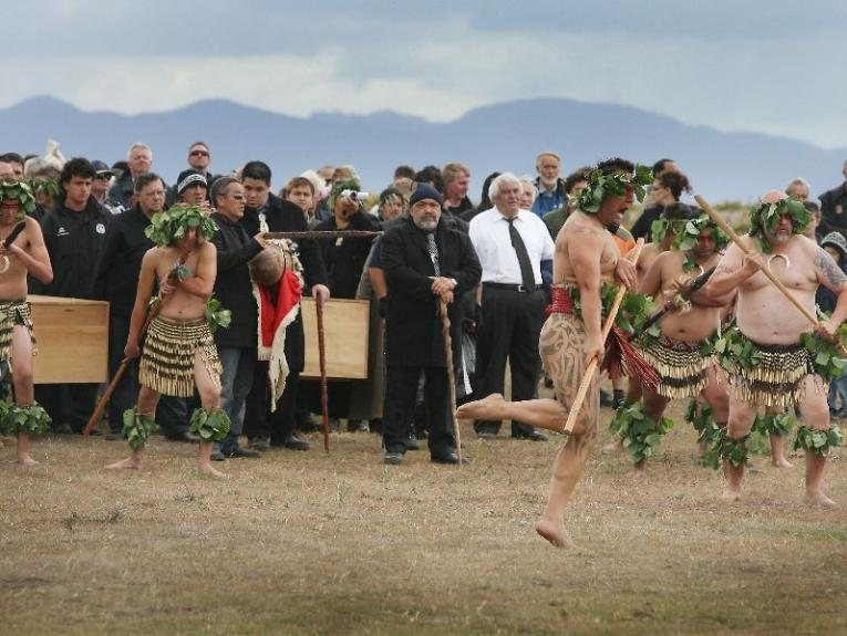 Picture of a repatriation at Wairau bar showing iwi holding caskets
