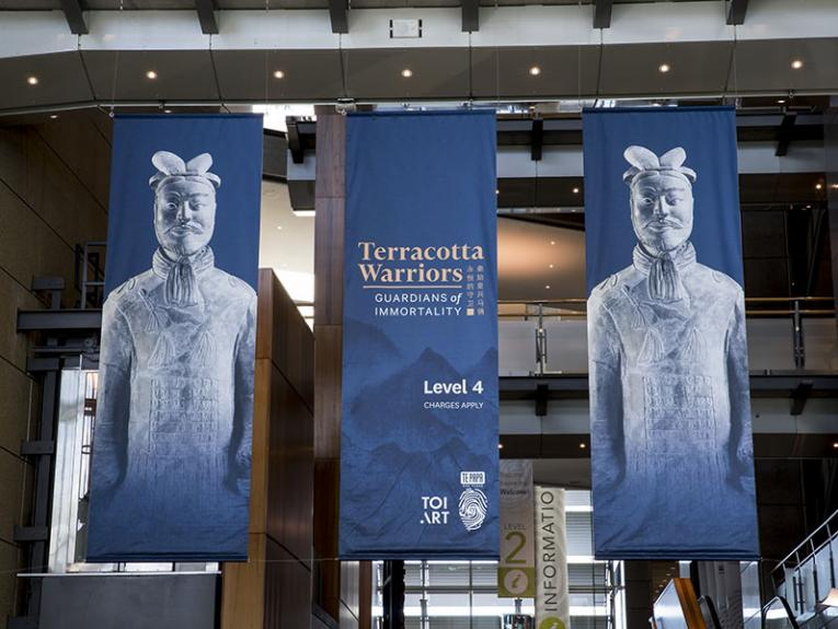 Banners advertising the Terracotta Warriors exhibition hang above the Te Papa entrance foyer