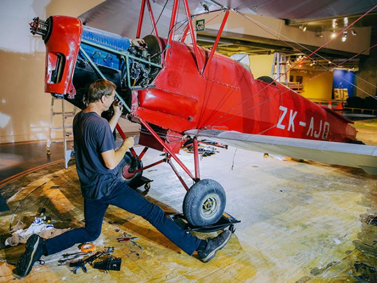 Tiger Moth plane is dismantled on the museum floor