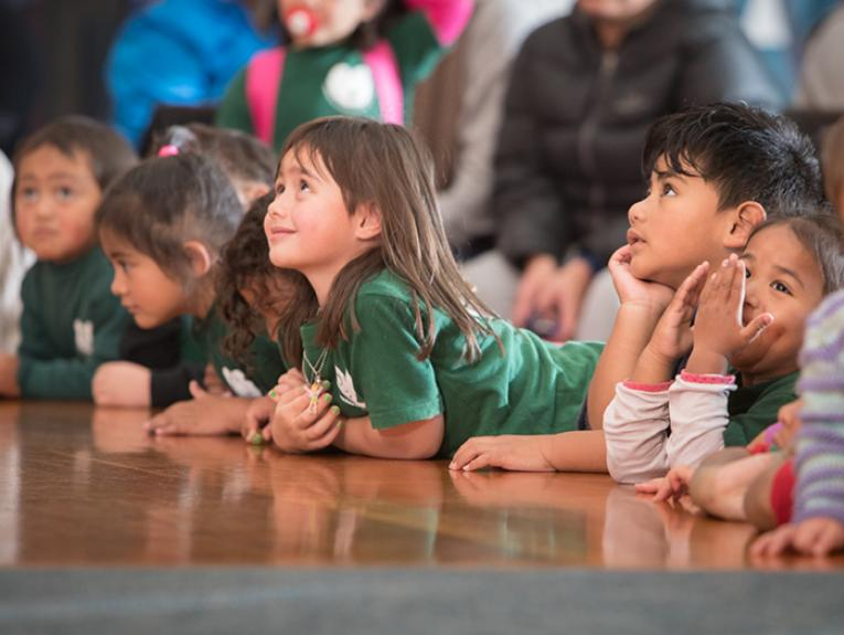 Child listening to a story on the marae during Matariki