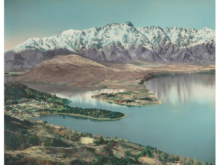 Queenstown. From the album: Hand coloured views of New Zealand; 1940 s; Whites Aviation, 1945-1960, Queenstown, by Whites Aviation. Purchased 1999 with New Zealand Lottery Grants Board funds. Te Papa (O.033079)