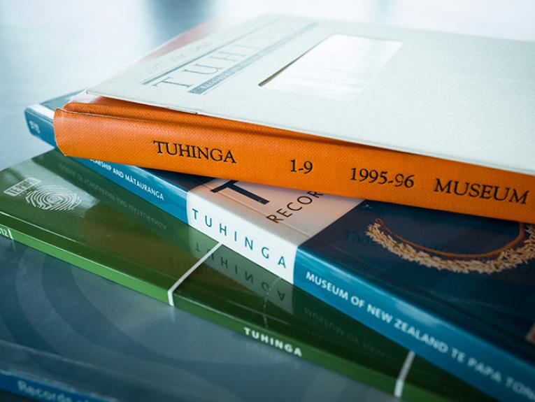 A pile of Tuhinga issues on a table