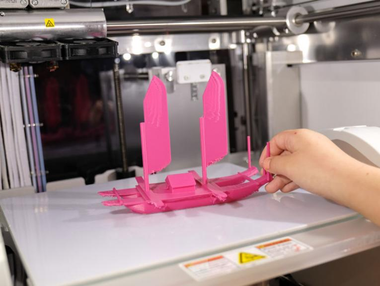 A pink vaka being 3d printed