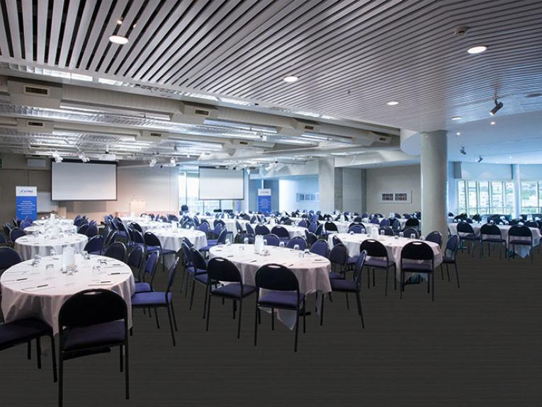 General view of the Oceania conference room, showing multiple tables set up with chairs
