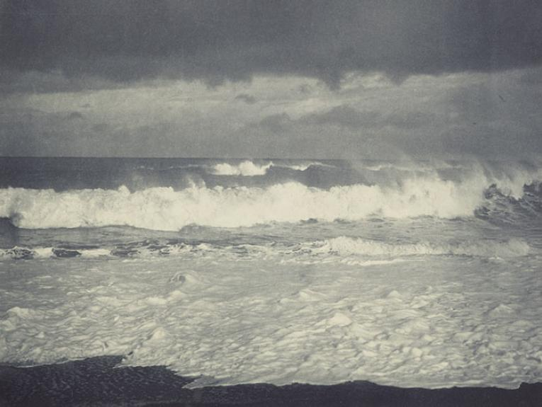 Photograph of a wave breaking on a beach