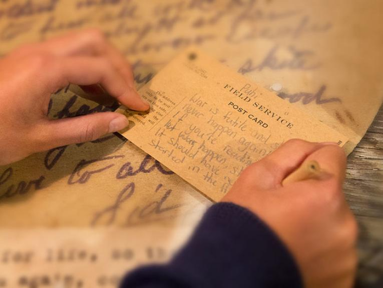 Child writing a note about war in the Gallipoli exhibition