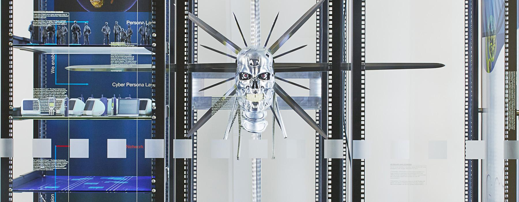 Simon Denny artwork featuring a silver skull