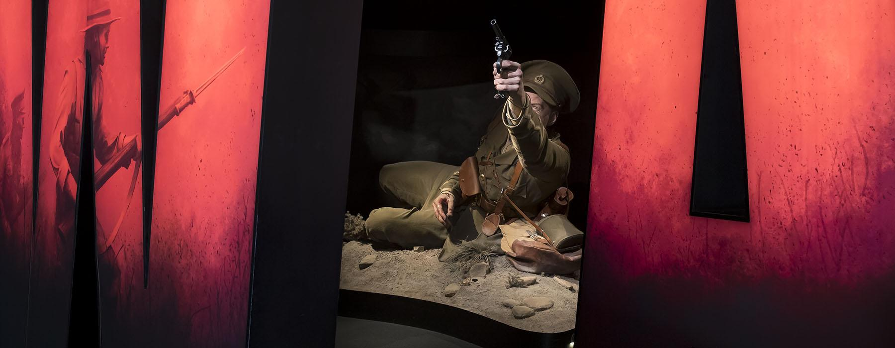 View looking through the entrance of the exhibition, Gallipoli: The Scale of Our War, showing a large wounded soldier drawing his gun