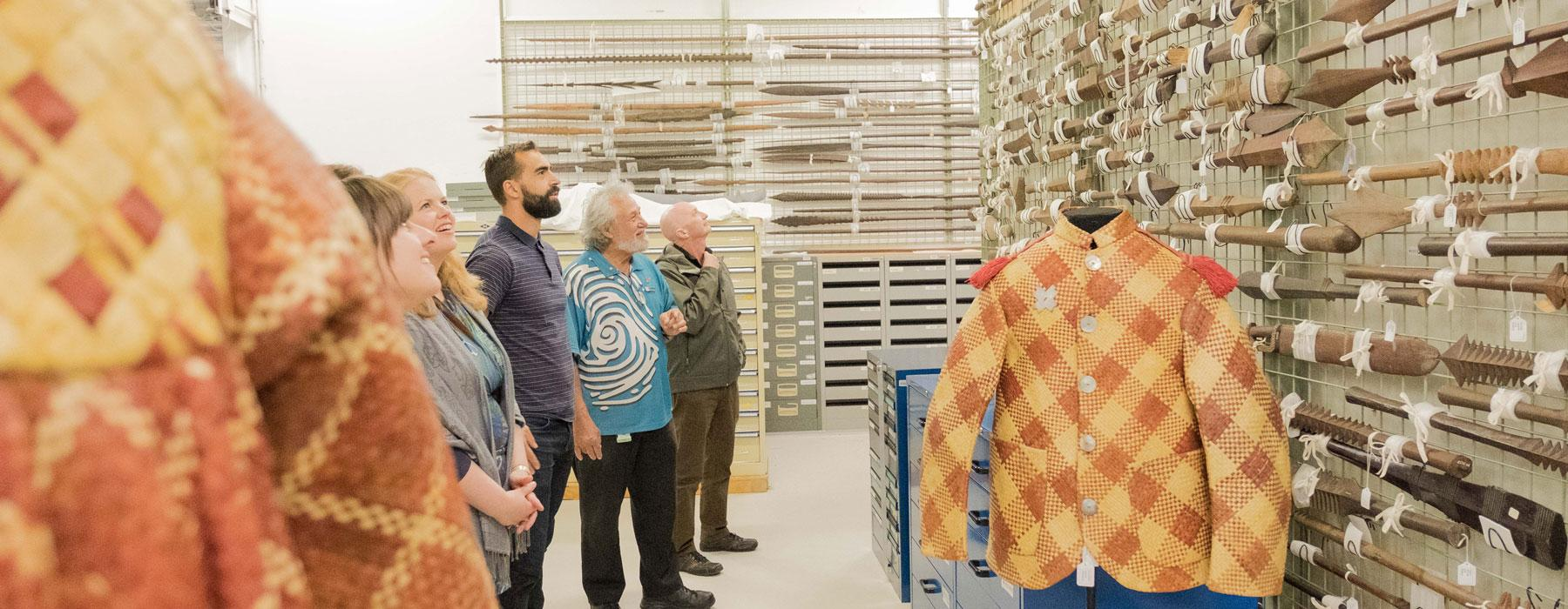 Tour group in the Pacific Cultures storeroom