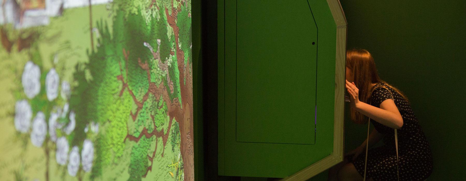 A girl looks through a door