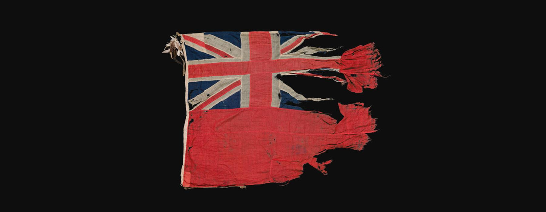 A torn red flag with a Union Jack on it
