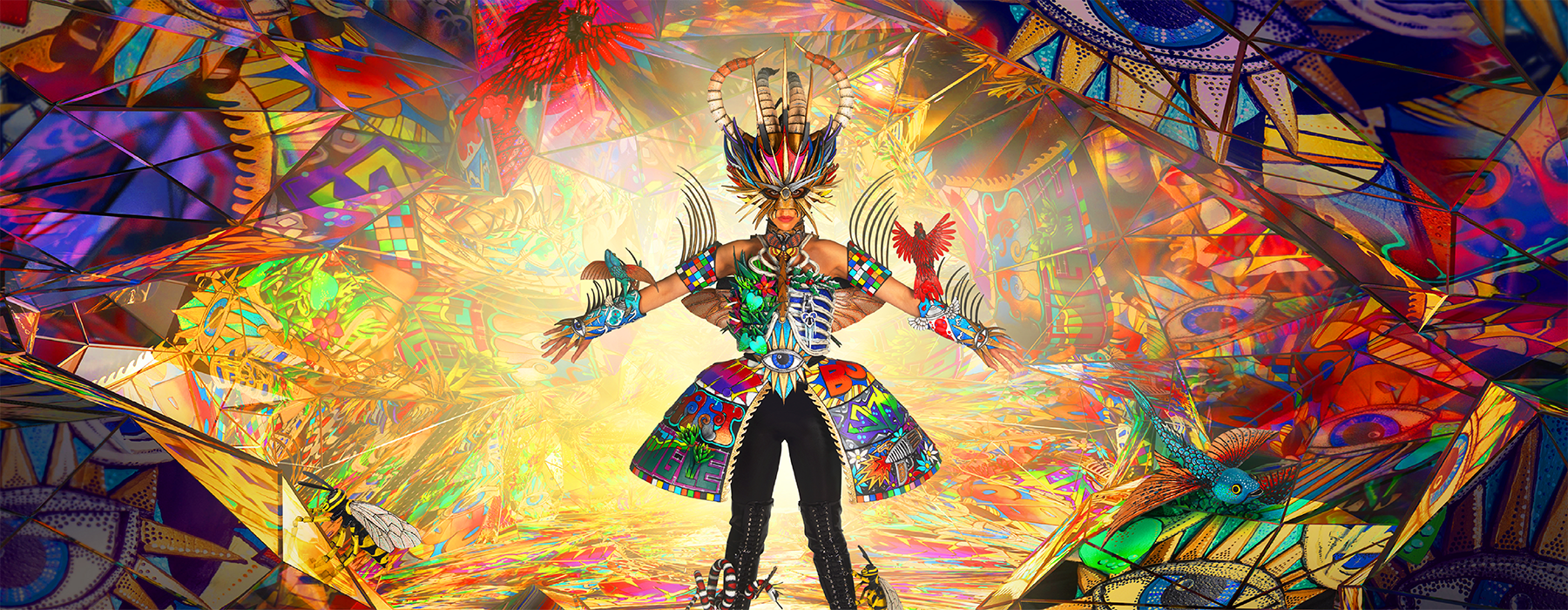 Colourful stage with a person in costume in the centre