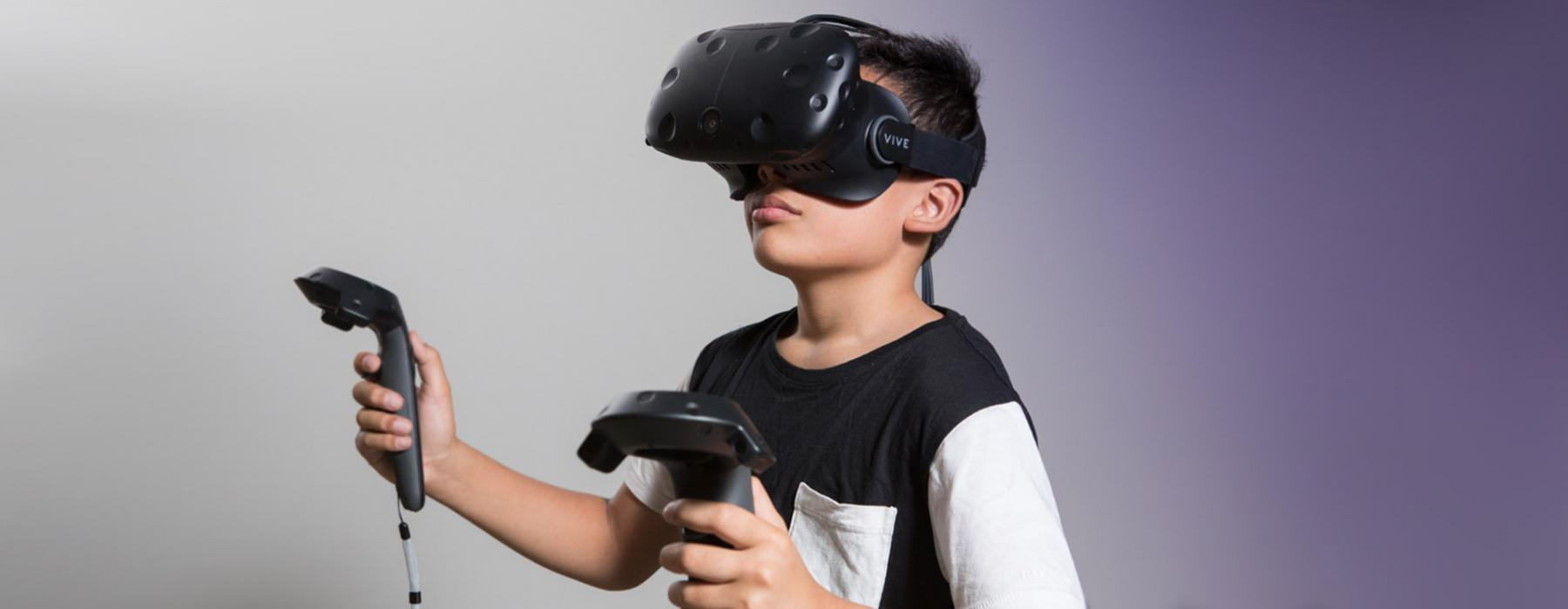 A child plays with virtual reality technology