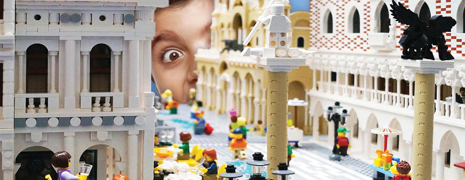 A boy looks at a LEGO town