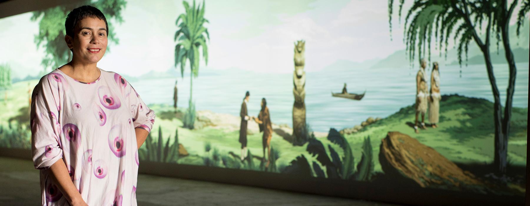 Lisa Reihana in front of her work art work