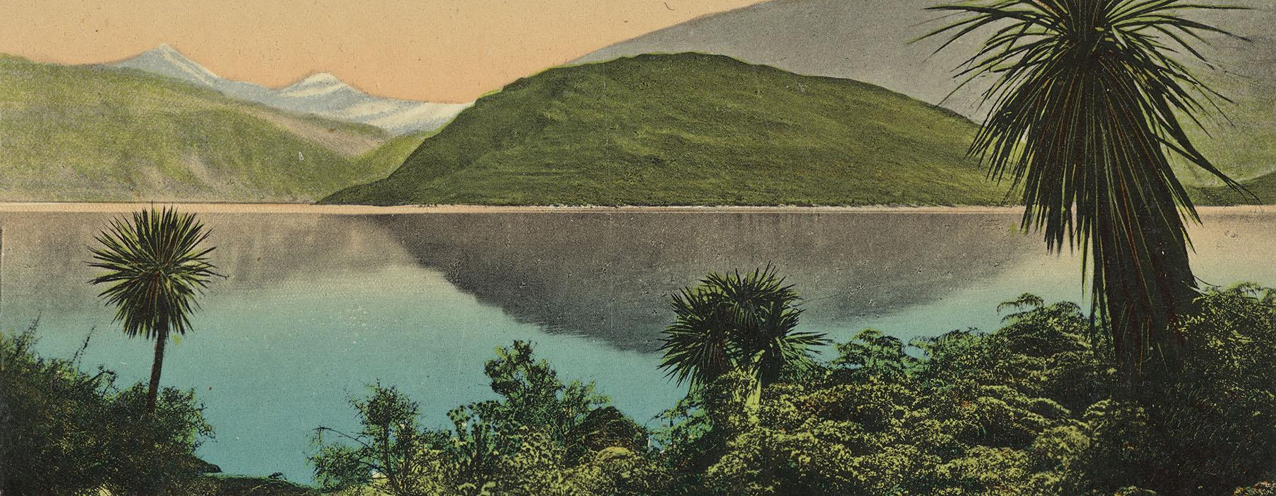 Detail of a colour postcard of Lake Wanaka with bush in the foreground, the lake in the middle, and hills in the background